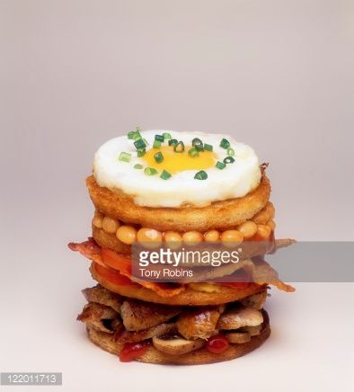 Stock Photo : A breakfast stack sandwich with fried egg on top