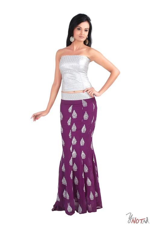 Silver Brocade Corset with Purple Lehenga By : Neha Kamal Sharda Description  Beautiful silver brocade corset with purple chiffon fishtail lehenga with embroidery all over.