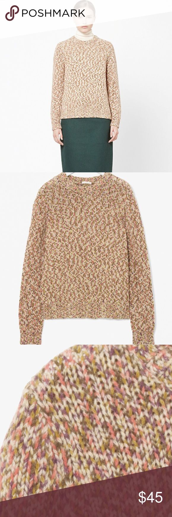 Cos MELANGE WOOL JUMPER MELANGE WOOL JUMPER Made from a melange wool mix , this multi-coloured jumper is a soft chunky knit. A regular fit, it has long sleeves and a round neckline. 55% Wool / 30% Polyamide / 15% Alpaca / Machine washable cos Sweaters
