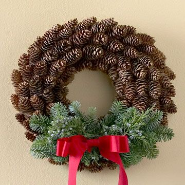 Pretty Pinecone Wreath  This wreath adds subtle holiday color to any room. Hot-glue pinecones to a wreath form, starting at the outside and working around the wreath toward the center. Wire evergreen sprigs to the bottom of the wreath, and hot-glue a simple red bow to the bottom center for a simple touch.