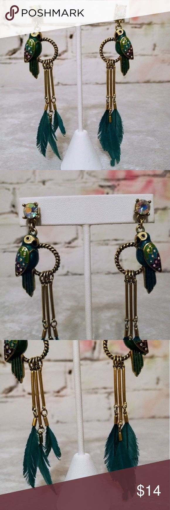 """🐦♥️ Betsey Johnson Jungle Fever Parrot Earrings Betsey Johnson Jungle Fever Parrot Earrings  - these earrings are definite standout and will get a lot of notice! - Gold earrings with green pretty feathers!  - iridescent stone on top  - multicoloured parrot wings with small stones for extra pop - 4"""" from top to bottom - earrings in great shape, I do not have the original card they came on. Betsey Johnson Jewelry Earrings"""