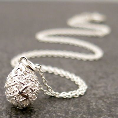 Weave Small Egg Pendant in Silver with White Sapphire gemstones.