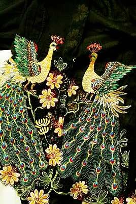 A richly detailed peacock motif on a nyonya kebaya (embroidery art from Penang in Malaysia).