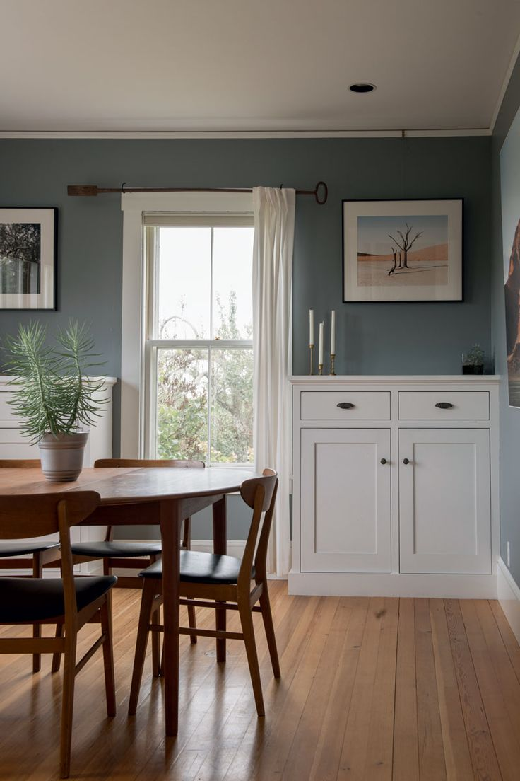 Midcentury dining set inside a rugged Maine #farmhouse.