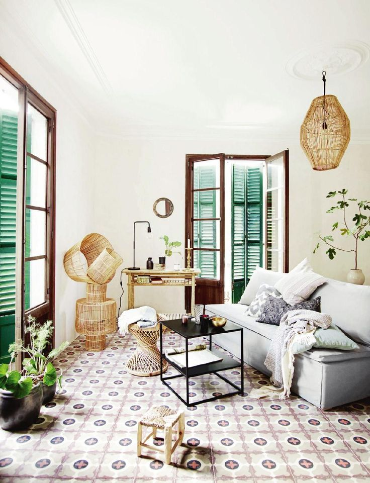 Bright boho room with green shutters and patterned tiles