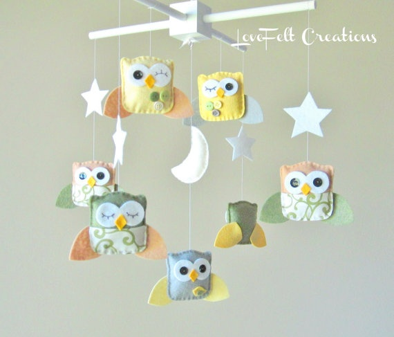 Baby mobile. Cute idea to make small stuffed animals to have a personalized one.