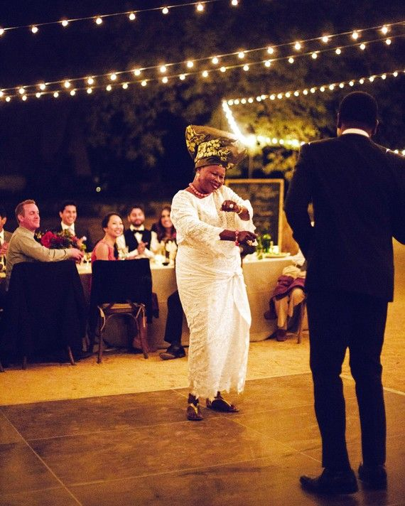 """The groom and his mother—who wore a traditional Nigerian outfit, including the """"gele,"""" a traditional head tie—danced to the song """"Sweet Mother"""" by Prince Nico Mbarga. Although the song (an ode to a wonderful mother) is 40 years old, it remains one of the most popular songs in West Africa."""