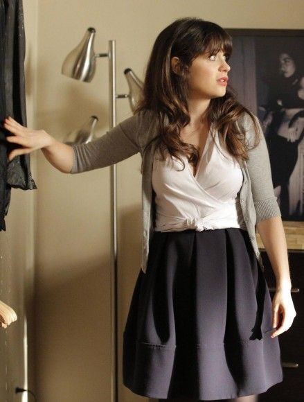 Zooey's white wrap top and box pleat skirt with grey cardigan on New Girl
