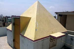 Sri Sai Pyramid Meditation Center,year of construction : 2010 size : 8ft x 8ft (roof top) | capacity : 10 persons cost incurred :  15,000 | type of structure : RCC private use technical support : S V Vijaya Krishna, +91 99080 42285  contact : Gajendra, +91 99080 42128 address : 8-87/2, 1st lane, Sri nagar colony, near Raghavendra nagar, Tirupati. http://www.pyramidseverywhere.org/pyramids-directory/pyramids-in-andhra-pradesh/rayalaseema/chittoor-district