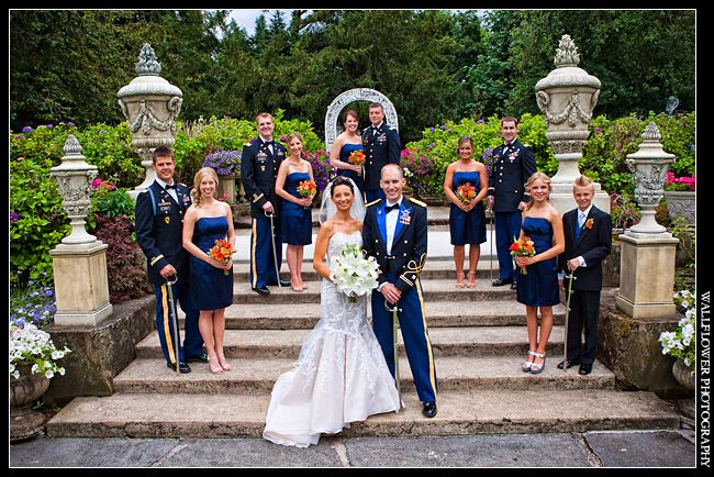 Photo of wedding party, including Army officers with sabers, before a wedding at Thornewood Castle in Lakewood, by Wallflower Photography of...