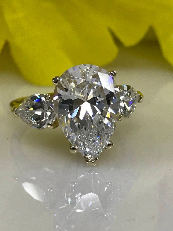 aeaa4784ad933 Pear shape engagement ring, with pear accents, 5.50ctw 14k yellow ...