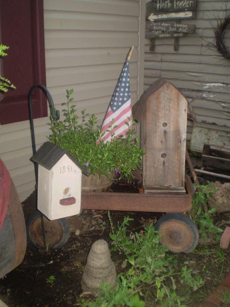 Old Wagon, birdhouse, & flag...Twigs Primitive Garden.