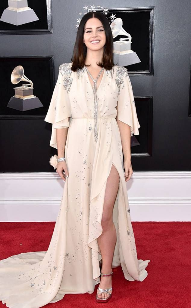 Lana Del Rey from Standout Style Moments From Grammys 2018  Not only is the singer celestial in this peachy nude and silver creation, but the custom Gucci crown topped off the look.