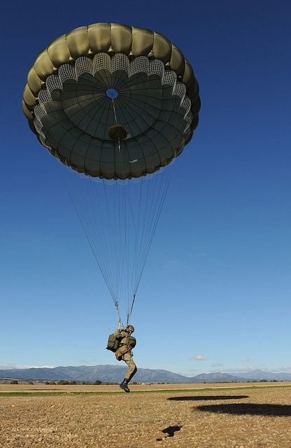 A paratrooper with 3rd Battalion the Parachute Regiment comes in to land on a Spanish drop zone during Exercise Iberian Eagle.