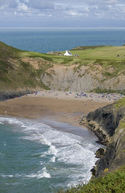 Mwnt beach, Ceredigion coast, West Wales, with Mwnt chapel on the hill above