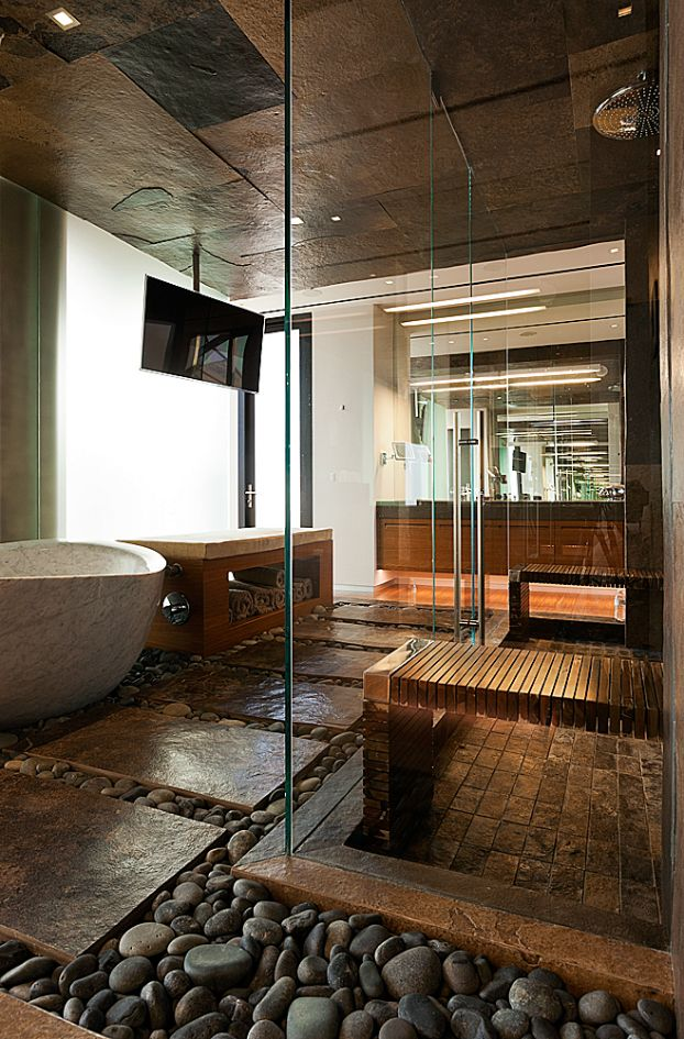 All the natural textures work together seamlessly to create a luxury zen ambiance in this bathroom.