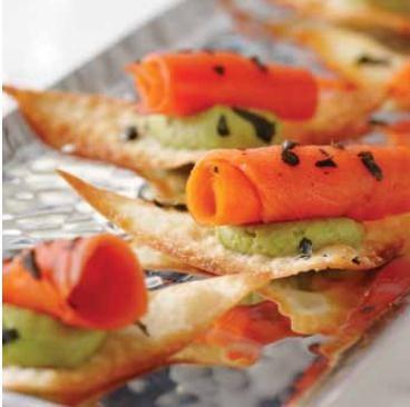 Smoked salmon spirals on wonton         crackers with wasabi-avocado foam