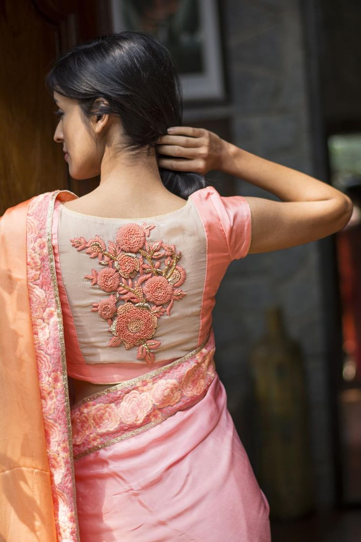 Offering exquisite sheer back blouses now! We decided to mix things up a bit and make some very interesting sheer back blouses. Check out this simple pink cap sleeved blouse with a stunning cream sheer back with a pinkish peach coloured appliqué of roses. Pair with a muted coloured saree in shades of pink peach or cream. Whatsapp +91 81050 68601. *Shipping worldwide* #saree #blouse #sareeblouse #blousedesigns #desi #indianfashion #india #bollywood #peach #silk