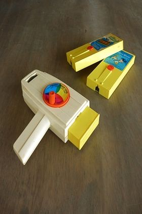 70's toy movie viewer and cartridges (fisher price). I had this as a kid, in fact, I'm looking at it right now. It's on my daughter's desk.