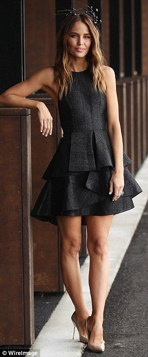 Classic beauty: Jodie Anasta stays on trend in a charcoal peplum dress...