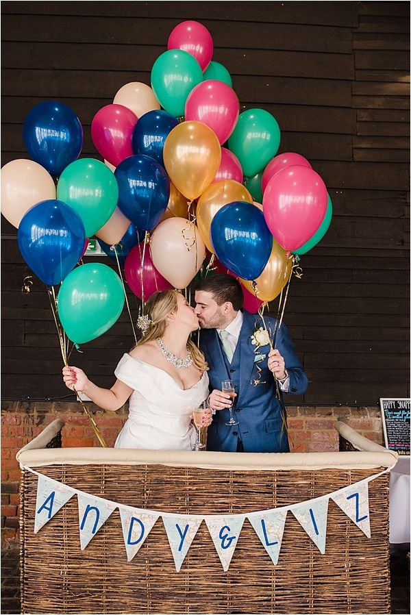 Vivienne Westwood Wedding Dress - Lillbrooke Manor Wedding - Jimmy Choo Shoes - Jenny Packham Jewellery - Cad & The Dandy Groom Suit - Gemma Sutton Hair and Make Up - Bright blue and pink bridal flowers. Hot Air Balloon and travel theme. Photo booth.