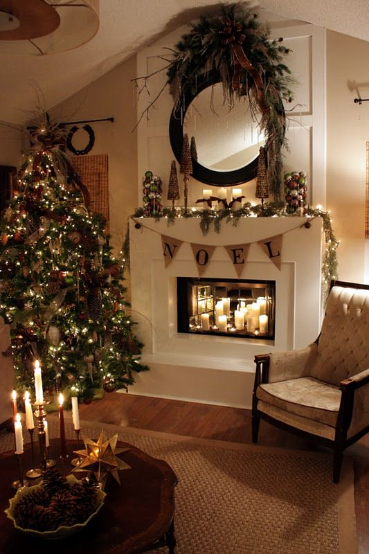 pretty mantle. Love the mirrors and candles in the fireplace - neutral christmas is always better than too much color! I love the mantle and the Noel. ** this is what I would do with a fireplace.