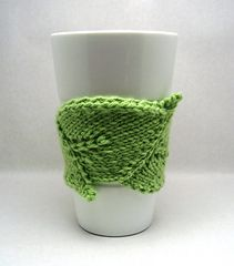 I designed this quick knit Cup Cuddler as a series of connected meandering leaves. It is seamed, pieced, and blocked. I recommend cotton yarn for a cold beverage Cup Cuddler and a wool/wool blend yarn for a hot beverage Cup Cuddler. It's a great pattern for using up those bits of yarn in your left over stash.