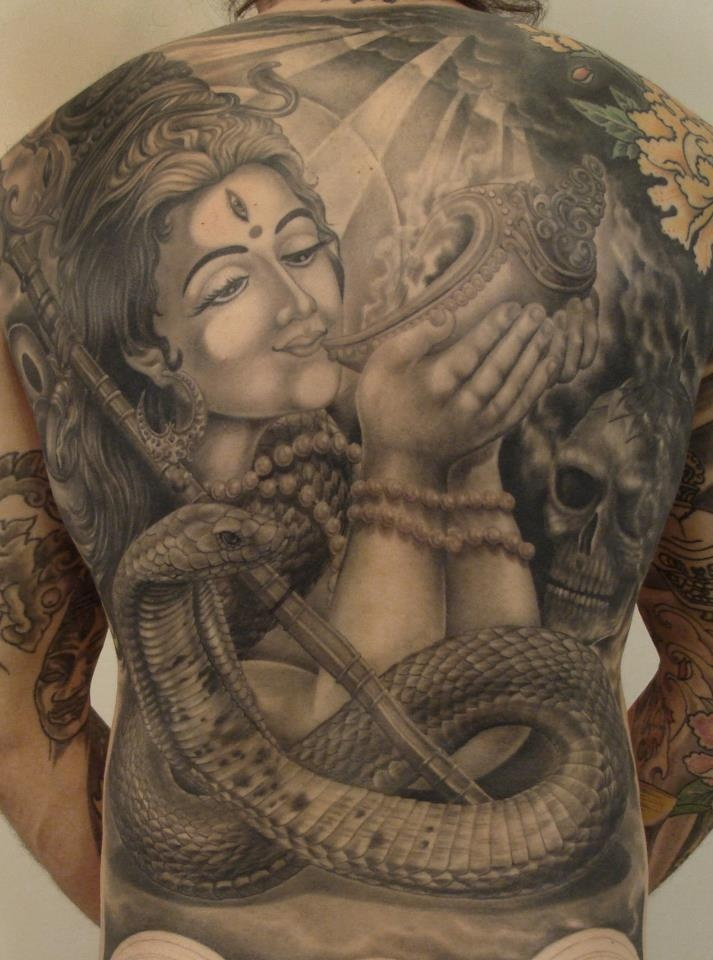 Artist: KHARISTATTOOS TORINO  Tattoo - Lord Shiva - Drinking the deadly poison churned out from the ocean by the devas and asuras.