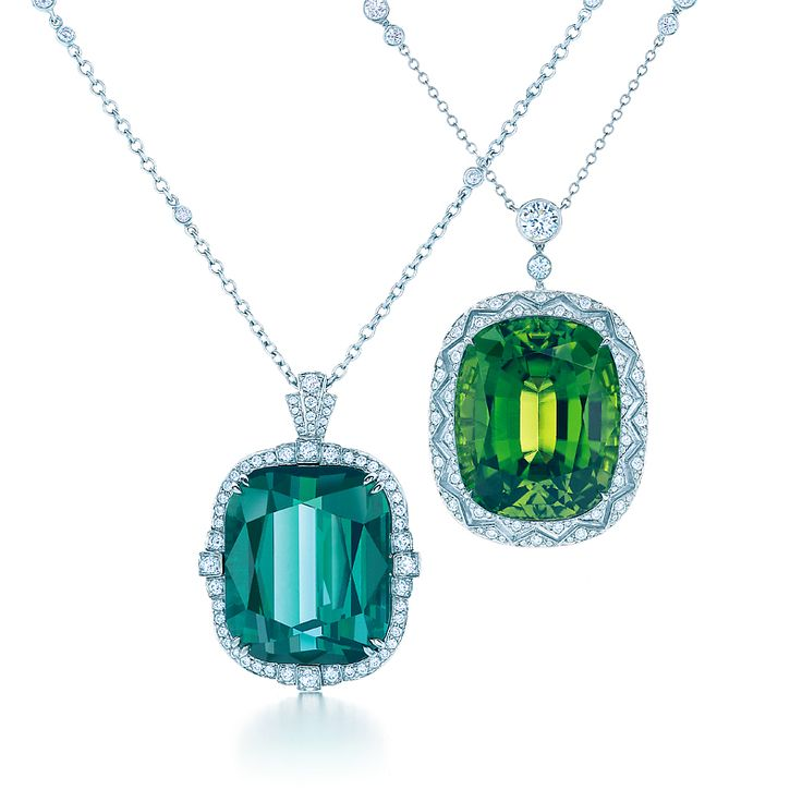 Pendants suspended from diamond and platinum chains. From left: cushion cut 30.64-carat green tourmaline with diamonds; cushion cut 30.77-carat peridot with diamonds. #TiffanyBlueBook #TiffanyPinterest