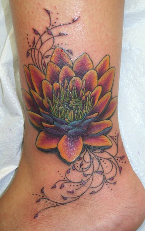 Lotus blossom Coverup on ankle-Colorful interpretation of a Lotus Blossom covering up a name on an ankle