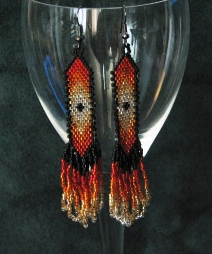 Uniquely beaded sparkly fire bursting colour looks amazing outlined in a matte black. Made with silver-lined miyuki delica beads and hand stitched bead by bead. $40. By Sister Bear Designs.