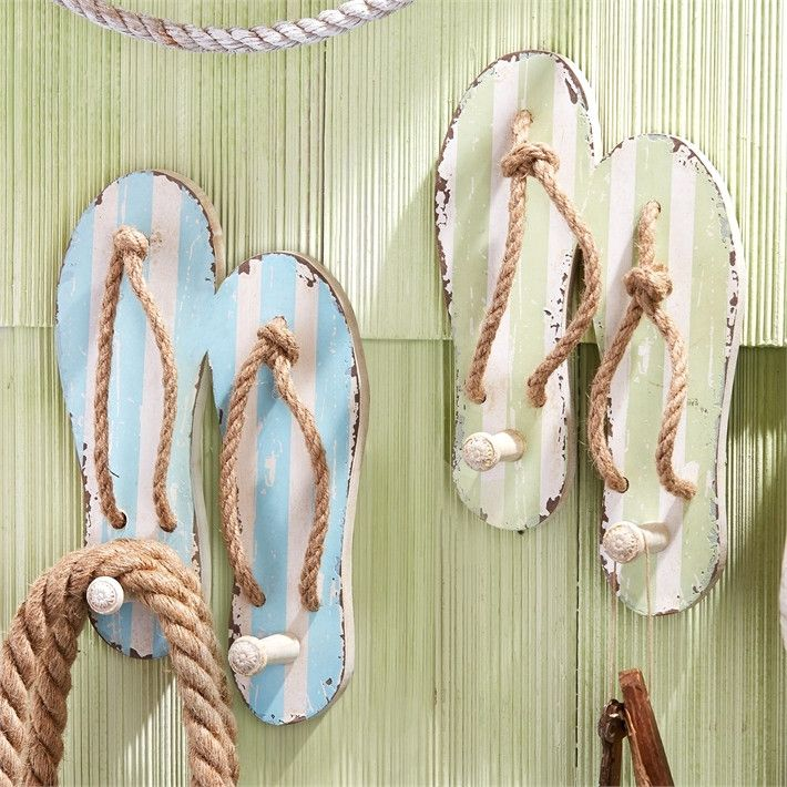 """Cute beachy flip flop wall hooks are just waiting to hold your towel and beach bags! Distressed wood with jute thongs each wall hook is a pair of flip flops with a wooden """"hook"""". Dimensions are 8""""long"""