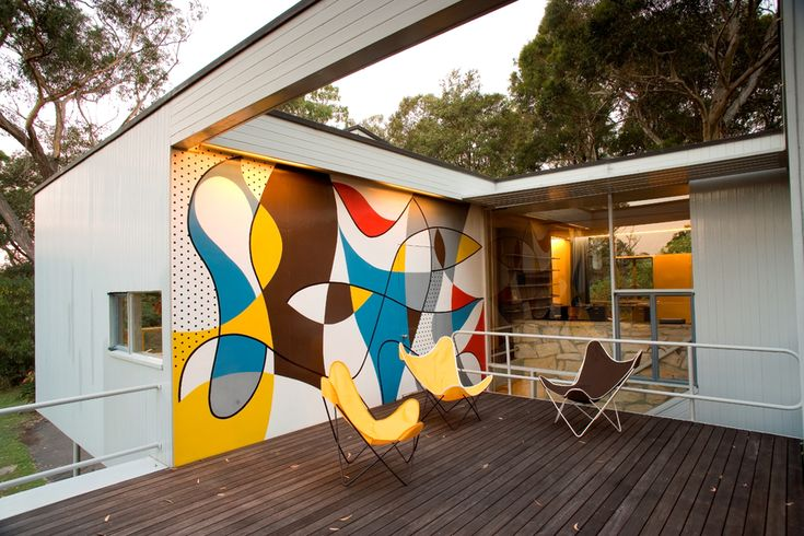 The mural at Rose Seidler House (designed by Harry Seidler) sundeck and reproduction Hardoy chairs. Photographer: Justin Mackintosh