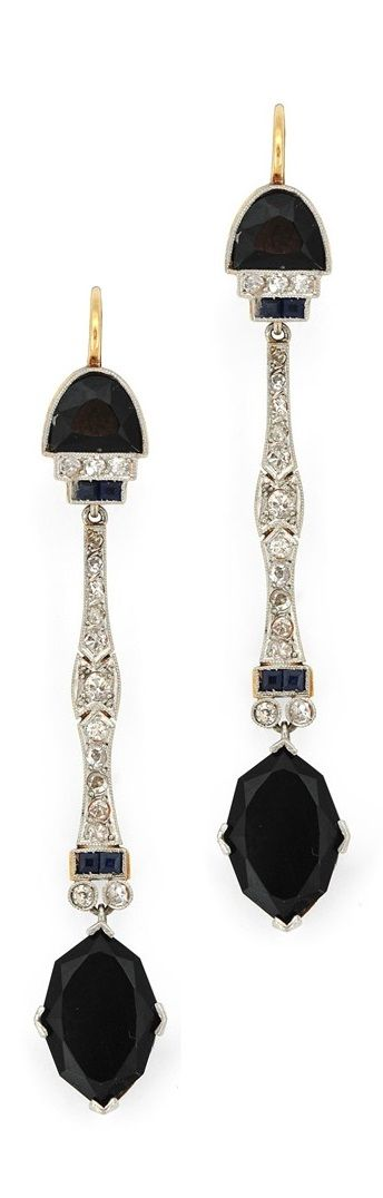 A pair of Art Deco platinum-topped gold, diamond, onyx and sapphire earrings, circa 1920.