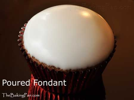 Poured Fondant Recipe - TheBakingPan.com - Poured fondant is a shiny, pourable sugar icing traditionally used to cover petit fours, and also makes a lovely glaze for cakes and cupcakes. It can be applied, as the name implies, by simply pouring over a cake and letting it drip down the sides. Many small cakes, such as petit fours or cupcakes can just be dipped in the fondant.