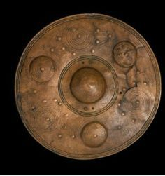 Bronze shield from Denmark. The bronze shields found in Danish bogs were made in central Europe in the period 1100-700 BC.  It is unlikely that the shields were used in war or battle. They were used in rituals. They were considered to be sun symbols closely associated with the gods and the cycle of the seasons. In the Scandinavian rock carvings too shields can be seen in connection with ritual dances.