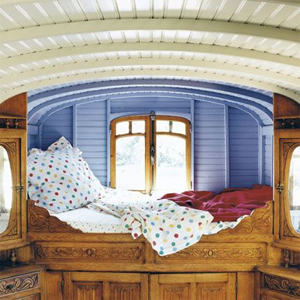 Maybe my guest house could be a gypsy caravan! I especially love the modern periwinkle blue walls with the antique cabinetry.