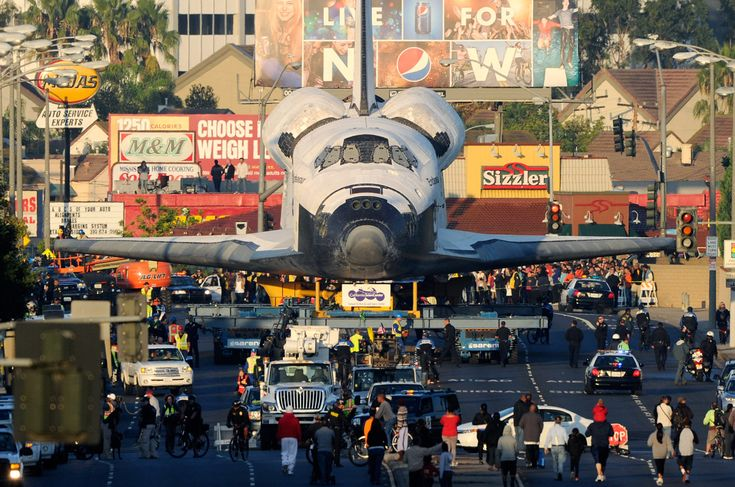 Phenomenal pictures of space shuttle Endeavour working its way through the streets of Los Angeles.  http://m.theatlantic.com/infocus/2012/10/a-space-shuttle-on-the-streets-of-los-angeles/100386/