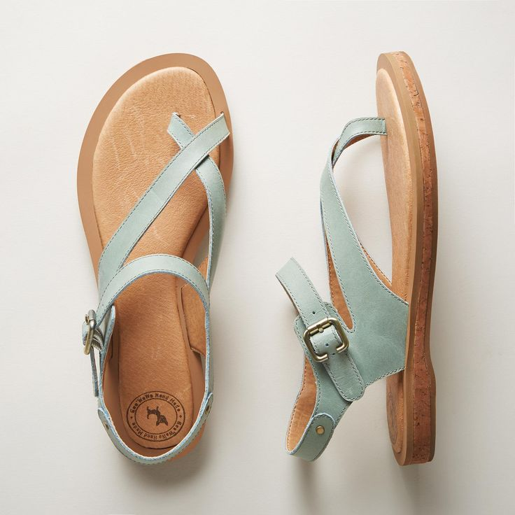 LYRIC SANDALS -- Asymmetrical, supple leather straps give a carefree elegance to these lighthearted cork-soled leather sandals. Inset cork sole and padded insole for all-day comfort. Imported. Whole and half sizes 6 to 10, 11.