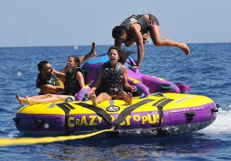 Water sports in Perivolos beach. Someone is ready to get off. Santorini island, Greece. - www.oiamansion.com