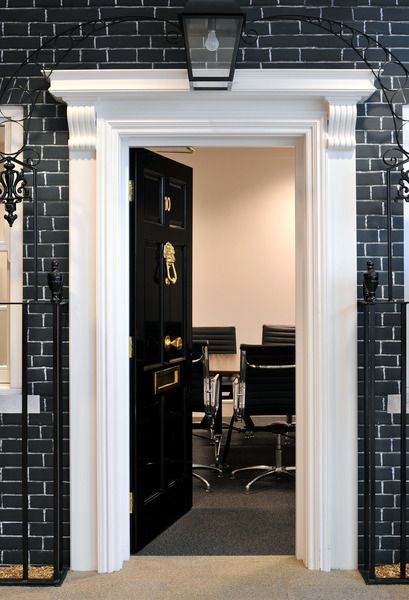 This quirky office design for Rackspace turned a meeting room into a replica of Number 10 Downing Street.  Other features of this office design included a mini cooper on the ground floor, artificial fireplaces and decking with fake grass.  See more of this office design in the video and case study:
