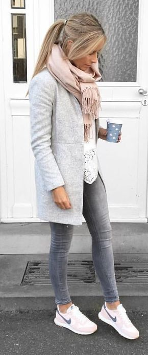 #spring #outfits woman in gray coat and gray jeans holding paper cup. Pic by @si…