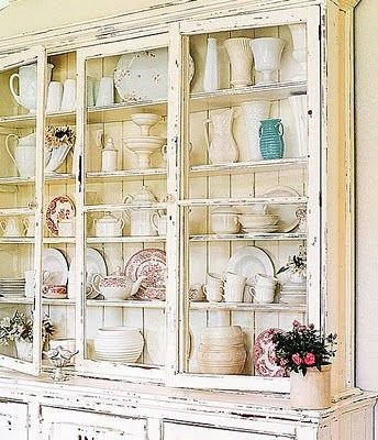 I already have the white dishes... Love this very time-worn look for China cabinet, may end up refinishing mine like that