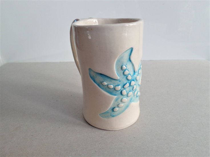 Stoneware starfish ceramic tea coffee mug, handmade unique coastal nautical beach white and blue mermaid pottery 220ml 8oz cup, Mother's day by MonikaWithaKCeramics on Etsy