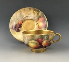Royal Worcester cup & saucer. Fruit painted, by William Ricketts.