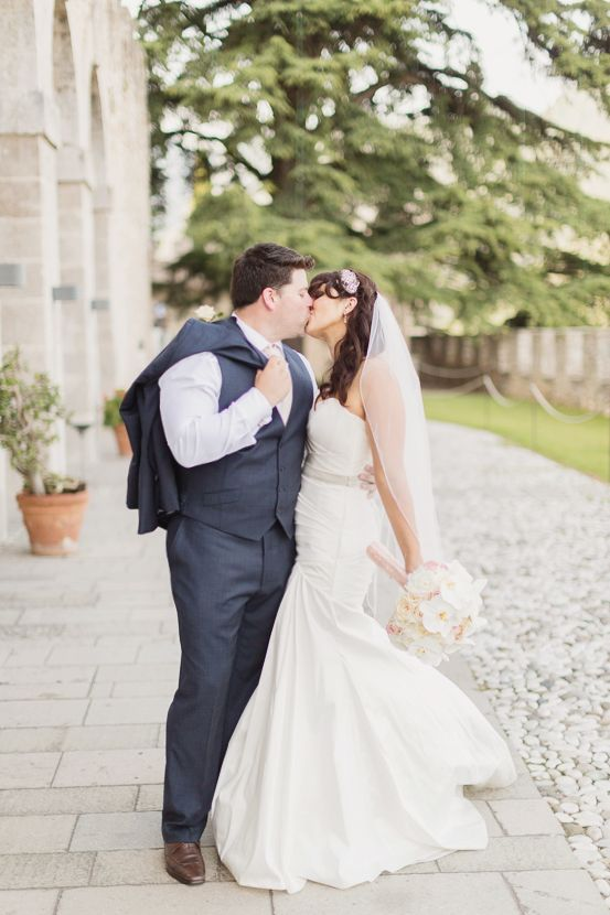 A beautiful couple gives a sweet #kiss shortly after their #wedding thrilling #ceremony, a picture of the pure #happiness! Photo by #FacibeniFotografia