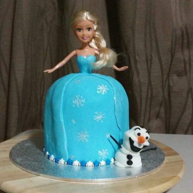 My attempt at an elsa cake, couldn't get a elsa barbie in time so I improvised
