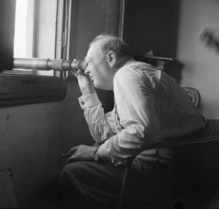 Tanner (Cpt) -- Winston Churchill uses a telescope to watch an assault against enemy positions north of Florence, from the observation post of a battery of the 66th (Lowland) Medium Regiment, Royal Artillery, 20 August 1944.