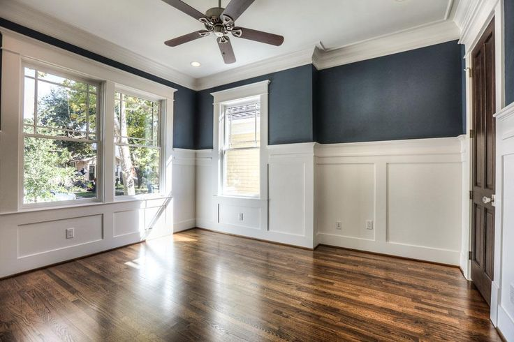 Master Bedroom with wainscoting, wood floors & wallpaper.