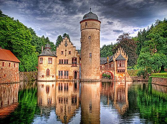 Schloss Mespelbrunn- Mespelbrunn Castle is a medieval moated castle on the territory of the town of Mespelbrunn, between Frankfurt and Würzburg, built in a remote tributary valley of the Elsava valley, within the Spessart forest. One of the most visited water castles in Germany.